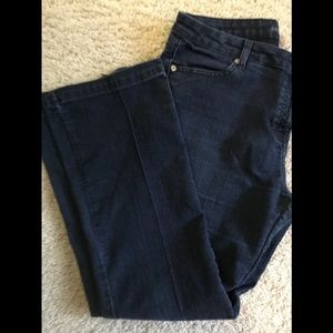 Michael Kors blue jeans w/back pocket flaw.